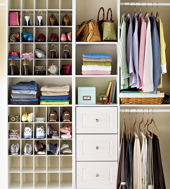 I love how organized everything seems in this fab small walk-in closet makeover Via Graceful Order – and the pouf/stool seems to be a must. I need to add one of those to my closet plans! I need to add one of those to my closet plans!
