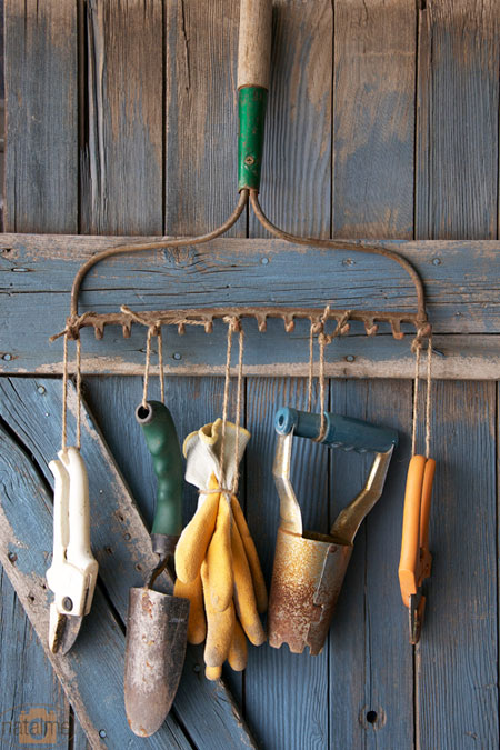 Recycled Rake used as a Garden Tool Holder