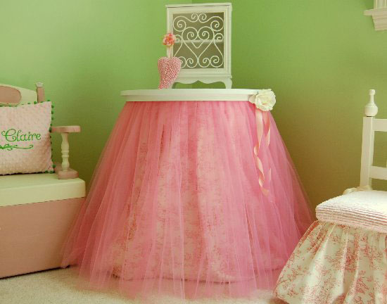 Tutu Table Skirt: A sheer layer of pink tulle over pink toile fabric creates a lovely end table