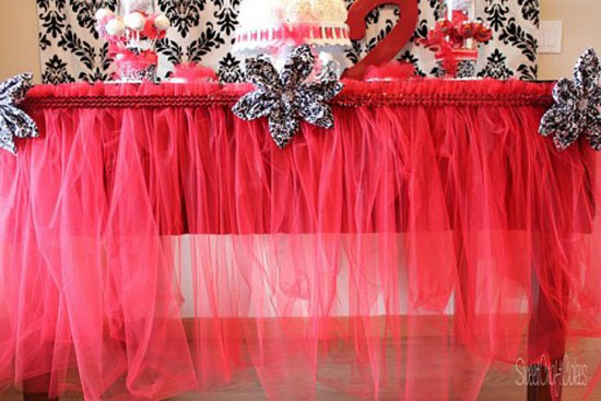 Tutu Table Skirt: Bright red tulle livens up this party table