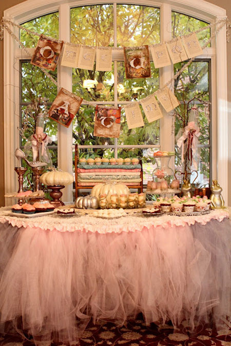 Tutu Table Skirt: Pink tulle helps set the mood for this baby shower buffet table
