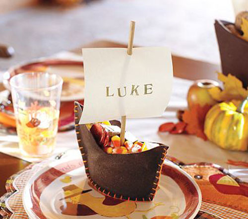 Kids Thanksgiving Table Ideas: These sailboat treat holders look just like the ones from Pottery Barn, but you make them yourself. And it's so easy to do! Filled with yummy treats, they also serve as place cards.