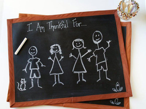 Kids' Thanksgiving Table Ideas: The kids can write down what they're thankful for on these easy-to-make chalk cloth placemats.