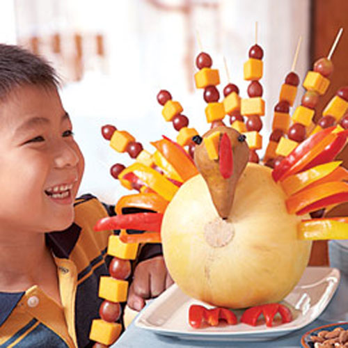 Kids Thanksgiving Table Ideas: Create a tasty and healthy snack to nibble on before the big meal. This fruit gobbler is as much fun to make as it is to eat.