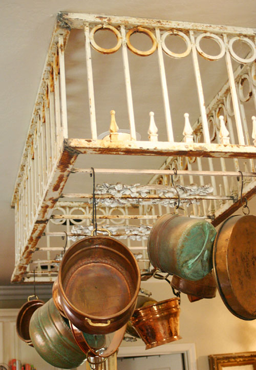 DIY Pot Rack Ideas: A weathered garden gate adds charm to this kitchen as a unique and useful pot rack.