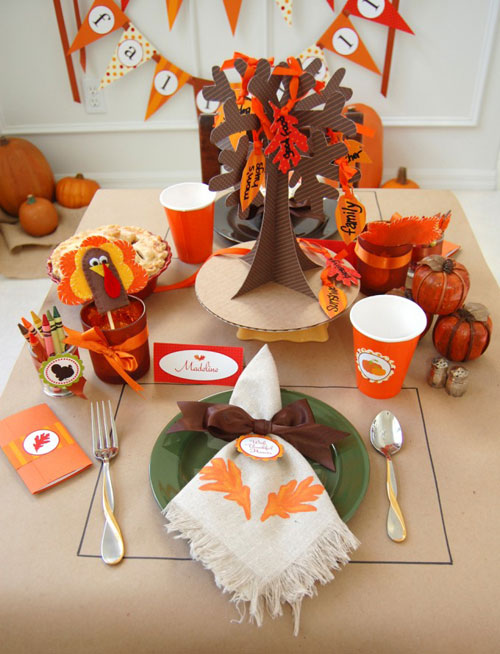 Kids Thanksgiving Table Ideas: Brown craft paper and Thanksgiving printables make for a fun kids' table. Placemats are drawn right on the paper with a black marker.