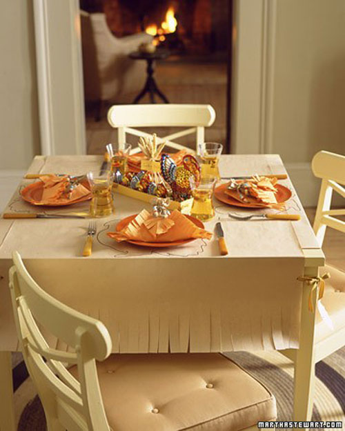 Kids Thanksgiving Table Ideas: Cover a table with craft paper and fringe the bottom to give it more style.