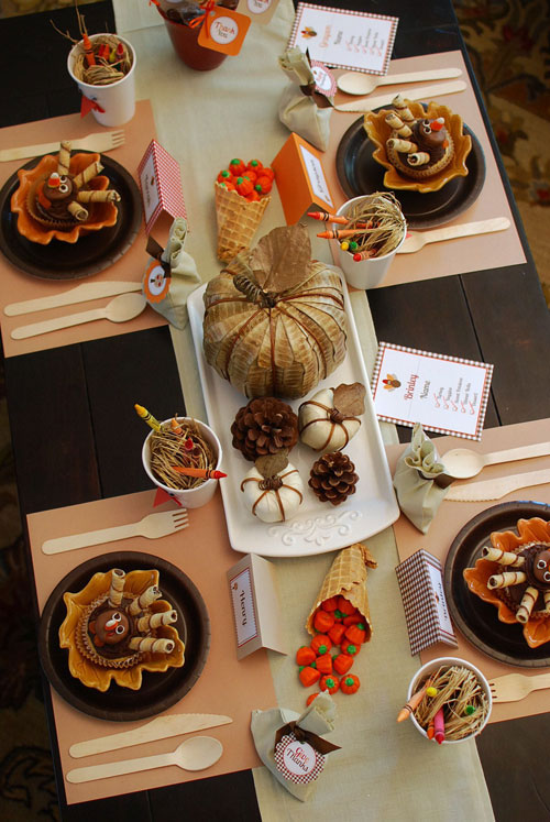 Kids Thanksgiving Table Ideas: Kid friendly can still be stylish. Keep them occupied with crayons and placemats they can draw on. Cornucopias made out of waffle cones and filled with pumpkin candies add the final touch.