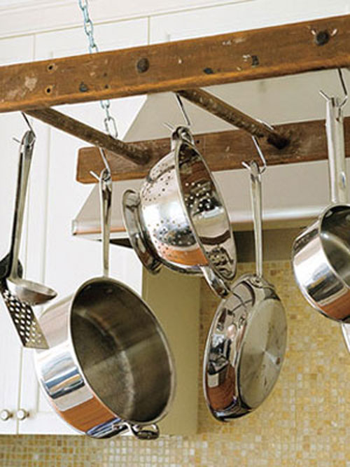 DIY Pot Rack Ideas: An old ladder is the perfect item to repurpose as a pot rack.