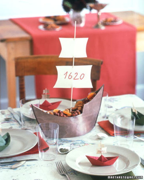 Kids Thanksgiving Table Ideas: Make a miniature Mayflower for the centerpiece. Fill it with nuts, candy or fruit then insert the mast and sails.