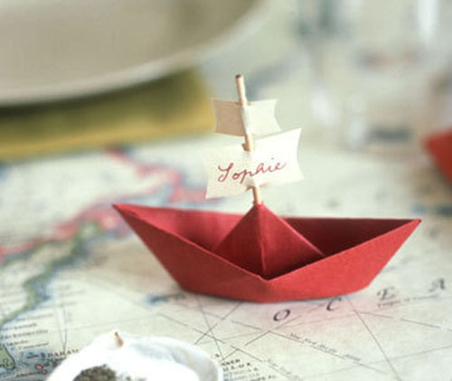Kids Thanksgiving Table Ideas: Make place card boats out of paper. This is a great project for kids to work on before dinner. With assistance, they can assemble the boats and write the names on the sails.
