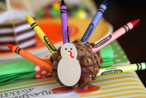Kids Thanksgiving Table Ideas: Bright crayons create a colorful turkey feather. Print up some Thanksgiving themed pages and keep kids busy while they wait for dinner.