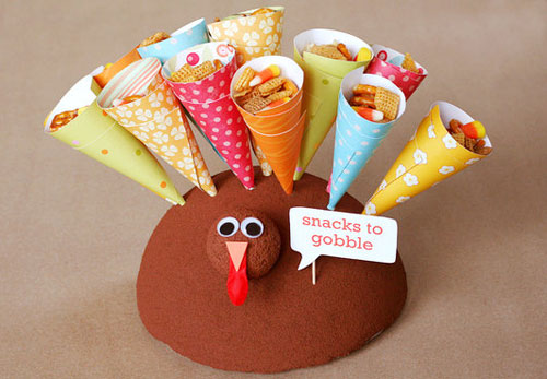 Kids Thanksgiving Table Ideas: These turkey treat holders are a fun way to serve snacks before the big meal.