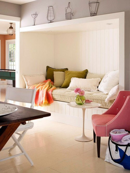 Reading Nooks: A recessed area covered in beadboard and an eclectic mix of pillows makes a cozy spot for reading.