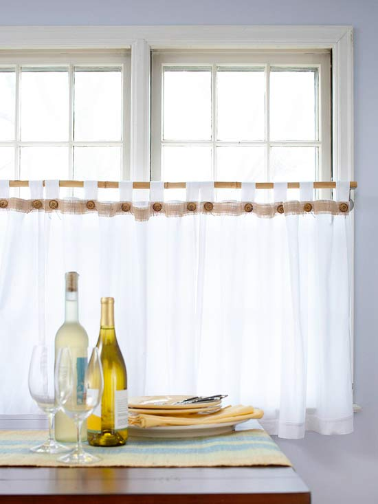 No-Sew Curtains: Ordinary white tab-top curtains have been accented with wood buttons and burlap. Both come of for washing, because they are attached with magnets. Tie hemp cord through each button and glue a magnet on the back. Cut burlap into a 1-1/2 inch strip. Pull off a few long threads to fringe the edge. Lay the burlap on top of the curtain, then put a magnetic button at each tab using another magnet behind them to secure them.
