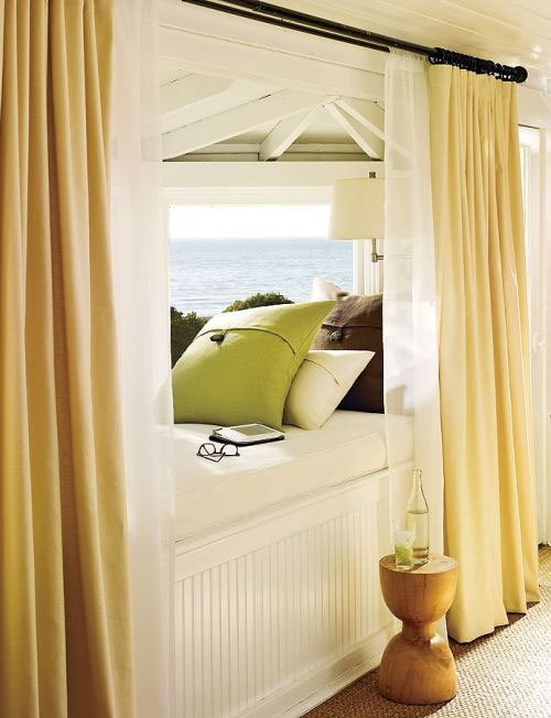 Reading Nooks: Flanked by curtains, this reading nook offers a fabulous waterview.