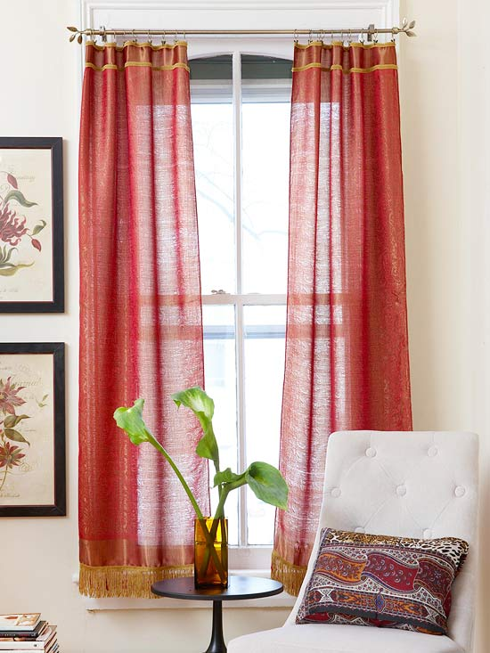 No-Sew Curtains: These curtains are made from shawls. The fringe on one end was cut away and decorative trim was hot-glued along the raw edge. Simple clip rings are used to hang them.