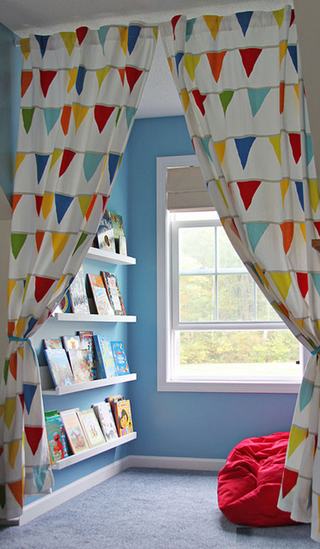 Reading Nooks: Simple bookshelves, fun curtains for privacy and a comfy pillow are all this reading corner needs to make it special.