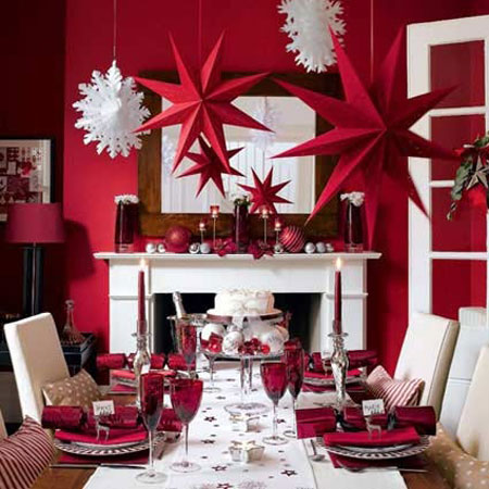 Christmas Table Ideas Using Red and White: Over-sized white snowflakes and red stars hung from the ceiling are both fun and dramatic.