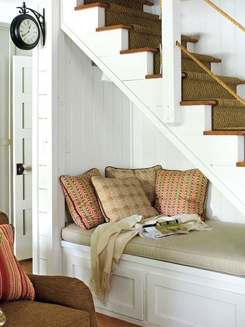 Reading Nooks: The unused space beneath the stairs is the ideal spot to create a cozy reading area.