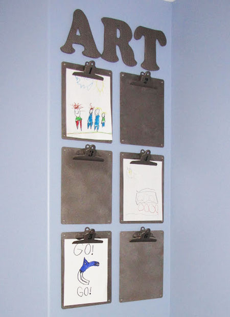 Ideas to Display Kid's Artwork: Dollar store clipboards and Styrofoam alphabet mats have been spray-painted in a dark silver metallic. The boards and letters are then attached to the wall for an ever-changing art display.