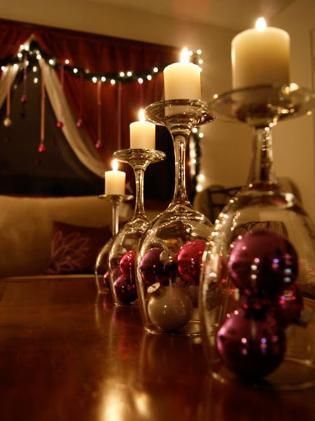 Christmas Centerpieces: This one is so creative! Turn stemmed goblets upside down to use as candle holders. Place decorative ornaments or lights underneath the upturned glasses.