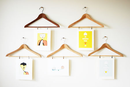 Ideas to Display Kid's Artwork: Wood suit hangers are repurposed as functional art hangers. Rotating new work is a snap.