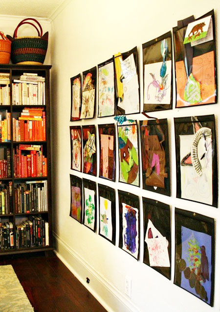 Ideas to Display Kid's Artwork: Attach individual heavy-duty sheet protectors to the wall and then slip in the latest masterpiece. Several rows make for an impressive display.