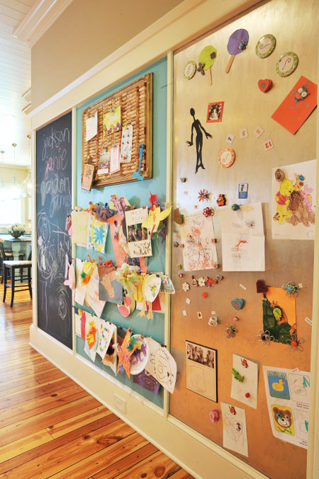 Ideas to Display Kid's Artwork: This creative wall consists of a chalkboard, bulletin board, magnetic board and cork board. All are fabulous ways to showcase a child's artwork.