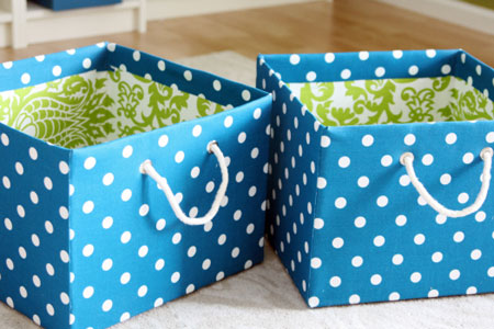 DIY Decorating Ideas: Fabric storage bins can be quite an investment; especially when you have to buy several. Save money and make your own out of boxes, inexpensive fabric and spray glue. Adding handles makes them easy to use. Fabric Covered Storage Boxes Tutorial