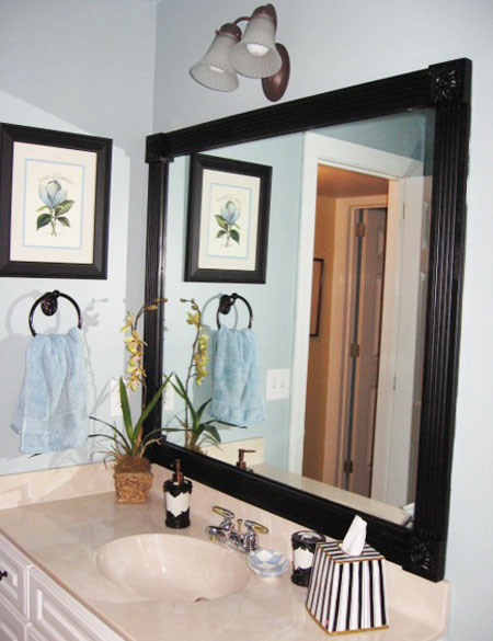 DIY Decorating Ideas: Give your bathroom an instant update by framing out those plain, boring mirrors. Fluted molding and corner rosettes done in glossy black paint give this mirror a custom look. Bathroom Mirror Frame Tutorial