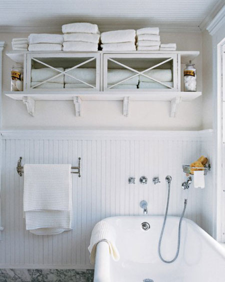 Bathroom Towel Storage Ideas: A flea market cabinet has found new life as a towel cabinet. Hung up just high enough on the wall to reach, it offers ample storage space without taking up a lot of room. A coat of white paint gives it a fresh, crisp look.