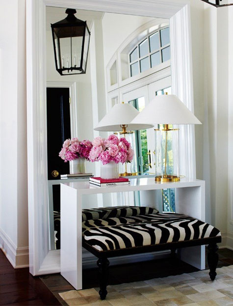 Entryway Ideas: Make a small entryway seem larger by adding a huge mirror that sits on the floor. Place a simple table and bench in front of it, add some accessories and voila! You've created a beautiful and inviting space.