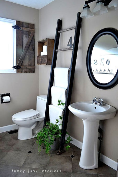 Bathroom Towel Storage Ideas: With several rungs, an old ladder offers a unique and charming way to store bath towels.