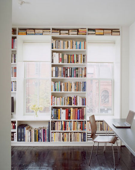 Small Space Storage Ideas: Surround a window with shelves. Use purchased units or cabinets to give the look of built-ins. Then run a shelf across the top from one side to the other to unite them. Or build them yourself with the help of this tutorial.
