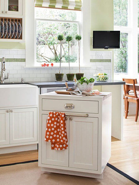 Small Space Storage Ideas: Add casters to the bottom of stock cabinetry. It offers much needed storage and additional prep space. When not in use, just roll it out of the way.