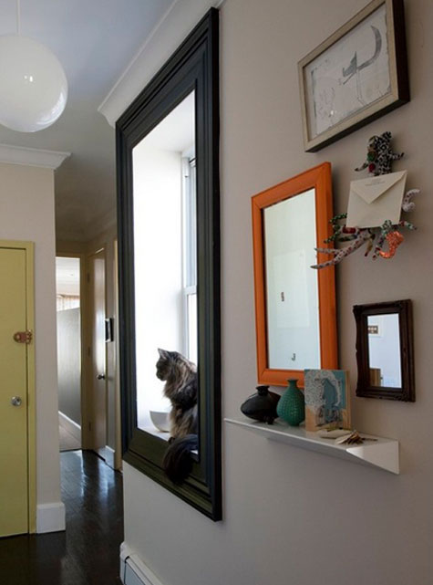 Entryway Ideas: If you don't have enough room to place a table on the floor, add a small narrow shelf on the wall. I don't know what that is that's holding the outgoing mail, but it's such a clever idea.