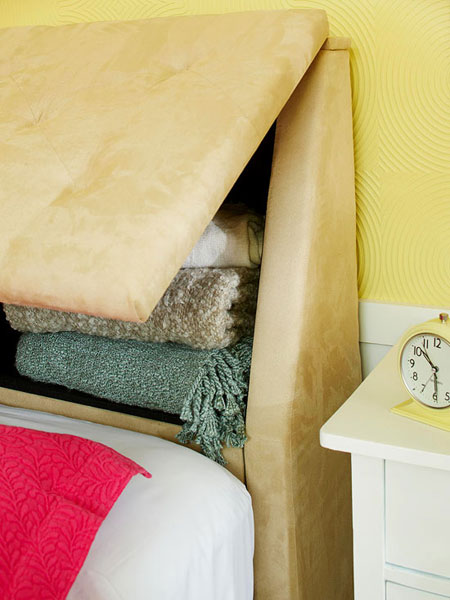 Small Space Storage Ideas: Make the most of limited space by using a headboard that features built-in storage.