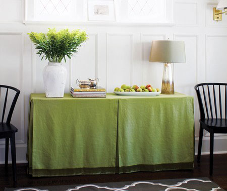 Small Space Storage Ideas: Hide file cabinets by covering them with a table skirt. Then, use the surface as a buffet or desk. Check out this great Table Skirt Tutorial.