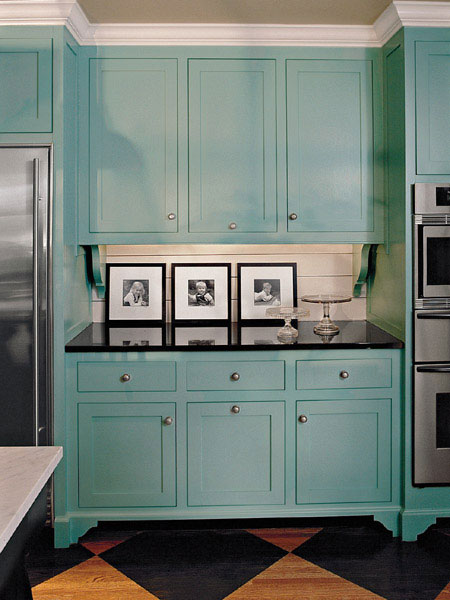 Turquoise Room Ideas: Painting traditional cabinets in turquoise and pairing them with black granite gives this kitchen a contemporary flair.