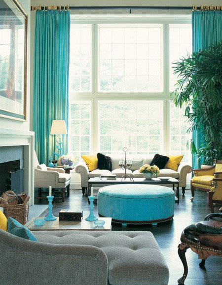 Turquoise Room Ideas: Floor-to-ceiling turquoise draperies make a bold statement in this glamorous living room.