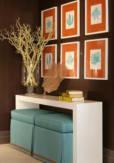 Turquoise Room Ideas: Brown, orange and turquoise are a winning combination in this hallway. The sharp white of the console is echoed in the artwork.