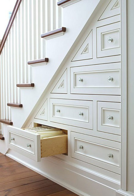 Small Space Storage Ideas: The unused area beneath the stairs is a great opportunity for storage. Add built-in drawers and increase the storage in a small space.