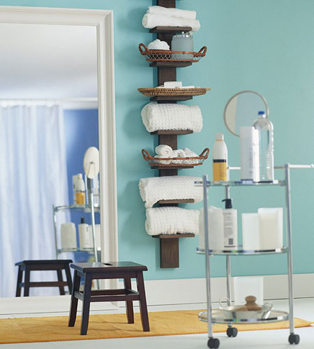 Bathroom Towel Storage Ideas: Think vertically when planning storage in a small bathroom. A tall wall spine bookshelf is a great way to save on space and store lots of towels.