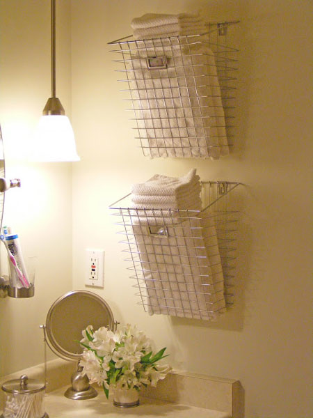 Bathroom Towel Storage Ideas: Chrome baskets hung on the wall offer a contemporary option for storing towels and facecloths.