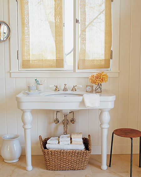 Bathroom Towel Storage Ideas: Baskets are fabulous for storage. Use a large woven basket to hold rolled up bath towels. Then place it conveniently near the shower or tub.
