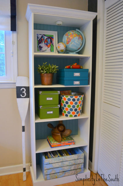 Bookcase Back Panel Ideas: Make a stock bookcase sturdier and add charm at the same time. Switch out the flimsy back panel with beadboard. Then paint it out to coordinate with the room.