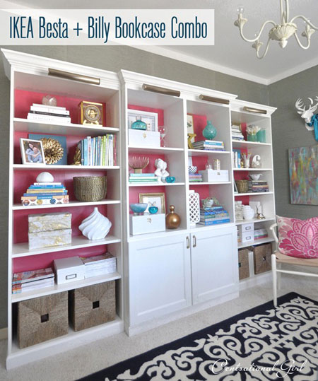 Ikea Hacks on Thrifty Thursday: Besta and Billy (sounds like a cute couple!) pieces are combined to create a large wall unit. Trimming it out with crown molding and specialty lights gives it a custom finish. A vibrant pink background adds even more pizzazz! Besta and Billy Bookcase Tutorial