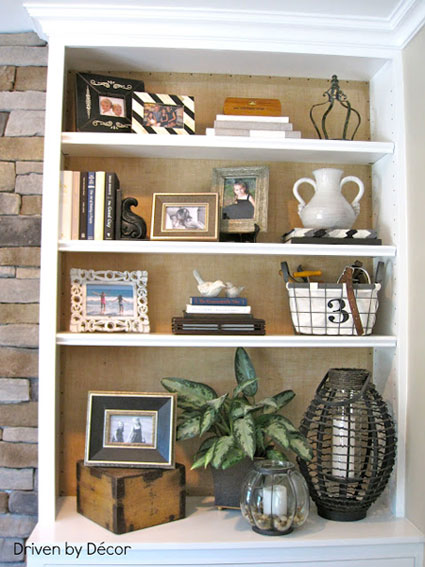 Bookcase Back Panel Ideas: Give warmth to an all white bookcase by adding burlap to the back panel. It quietly highlights whatever you place on the shelf.