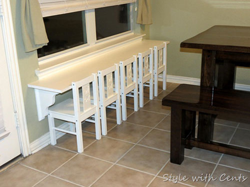 "DIY Decorating Ideas: If you need to seat several kids in a small space, here's a fabulous solution for you. Make them their own ""breakfast bar"" or as the designer calls it ""table for five"". Kid-Size Breakfast Bar Tutorial"